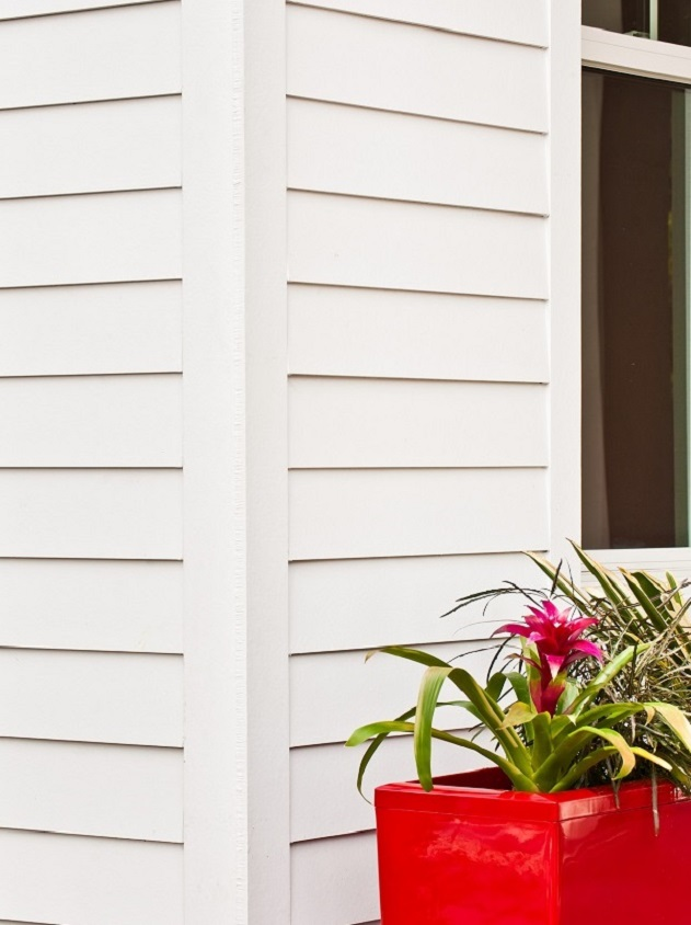white siding with planter